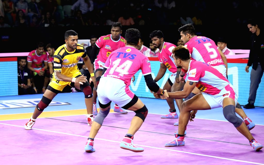Players in action during Pro Kabaddi Season 7 match between Jaipur Pink Panthers and Telugu Titans at Thayagraj Sports Complex in New Delhi on Aug 24, 2019.