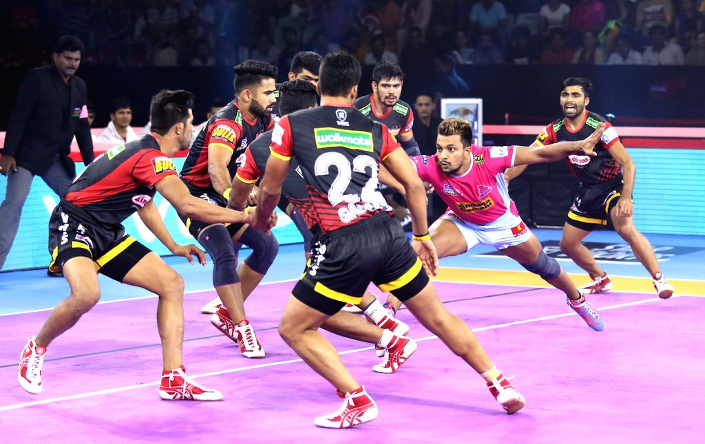 Players in action during Pro Kabaddi Season 7 match between Jaipur Pink Panthers and Bengaluru Bulls at Thayagraj Sports Complex in New Delhi on Aug 25, 2019.