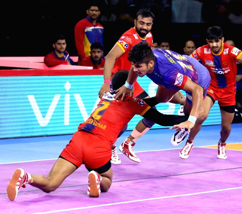 Players in action during Pro Kabaddi Season 7 match between Dabang Delhi and UP Yoddha at Thayagraj Sports Complex in New Delhi on Aug 25, 2019.