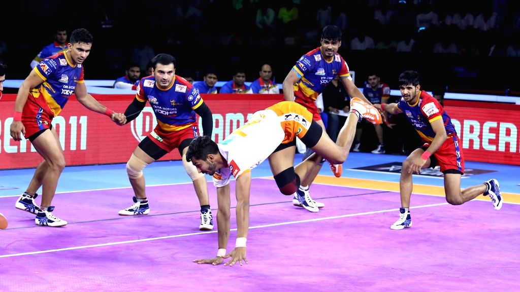 Players in action during Pro Kabaddi Season 7 match between UP Yoddha and Puneri Paltan at Thayagraj Sports Complex in New Delhi on Aug 26, 2019.