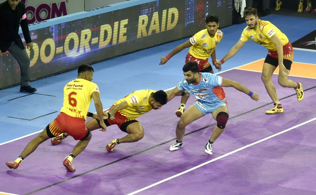 Players in action during Pro Kabaddi Season 7 match between Bengal Warriors and Gujarat Fortunegiants in Kolkata on Sep 7, 2019.