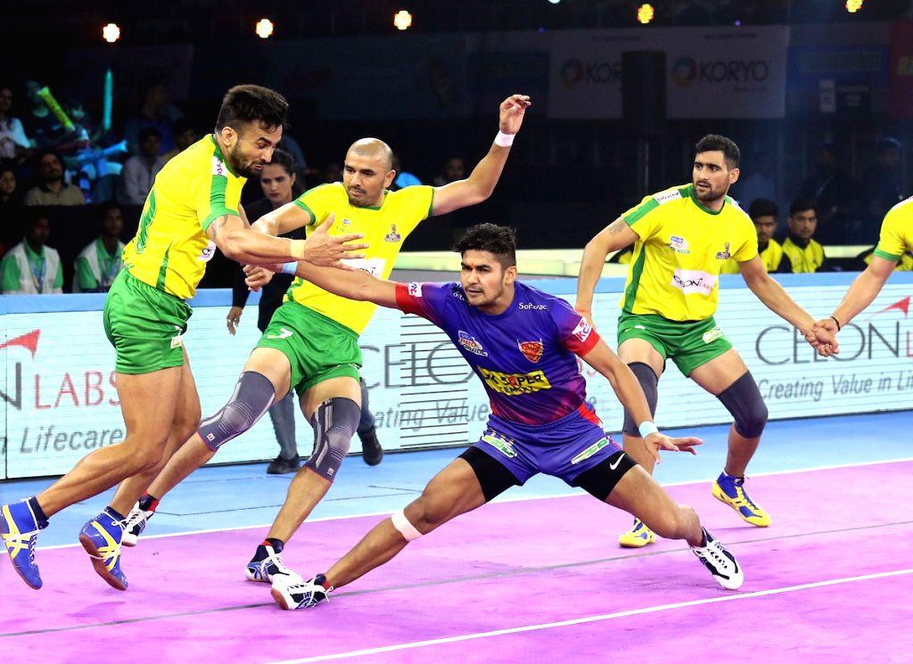 Players in action during Pro Kabaddi Season 7 match between Dabang Delhi and Tamil Thalaivas at the Netaji Subhash Chandra Bose Indoor Stadium in Kolkata on Sep 8, 2019.