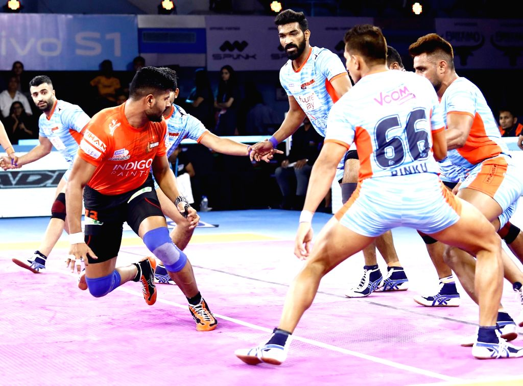 Players in action during Pro Kabaddi Season 7 match between Bengal Warriors and U Mumba at the Netaji Subhash Chandra Bose Indoor Stadium in Kolkata on Sep 11, 2019.