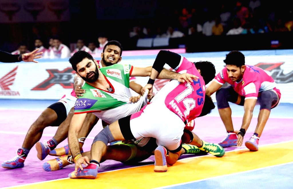 Players in action during Pro Kabaddi Season 7 match between Jaipur Pink Panthers and Patna Pirates at the Netaji Subhash Chandra Bose Indoor Stadium in Kolkata on Sep 12, 2019.
