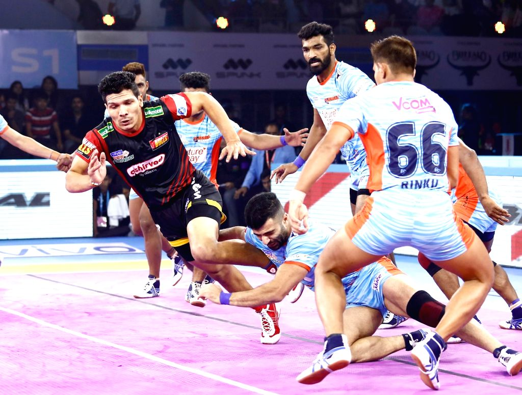 Players in action during Pro Kabaddi Season 7 match between Bengal Warriors and Bengaluru Bulls at the Netaji Subhash Chandra Bose Indoor Stadium in Kolkata on Sep 12, 2019.