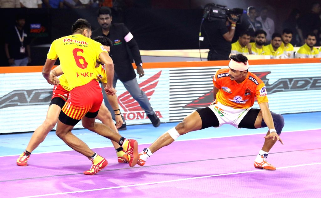 Players in action during Pro Kabaddi Season 7 match between Puneri Paltan and Gujarat Fortunegiants at Shree Shiv Chhatrapati Sports Complex in Pune on Sep 14, 2019.