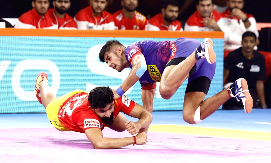 Players in action during Pro Kabaddi Season 7 match between Dabang Delhi KC and Gujarat Fortunegiants at Shree Shiv Chhatrapati Sports Complex in Pune on Sep 15, 2019.