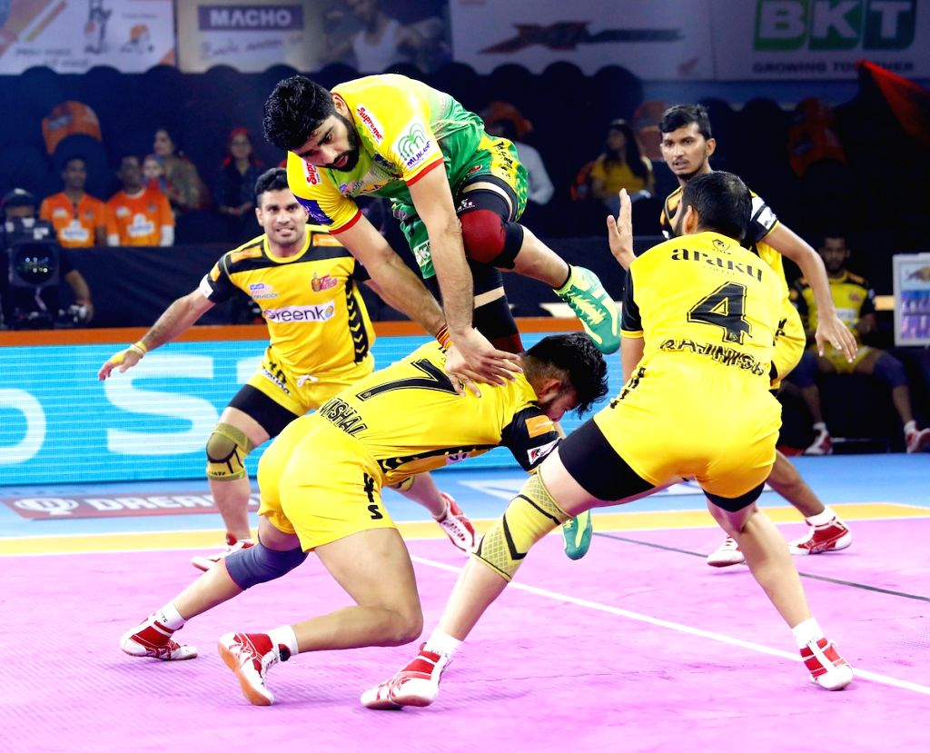 Players in action during Pro Kabaddi Season 7 match between Telugu Titans and Patna Pirates at Shree Shiv Chhatrapati Sports Complex in Pune on Sep 20, 2019.