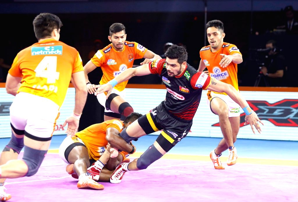 Players in action during Pro Kabaddi Season 7 match between Puneri Paltan and Bengaluru Bulls at Shree Shiv Chhatrapati Sports Complex in Pune on Sep 20, 2019.