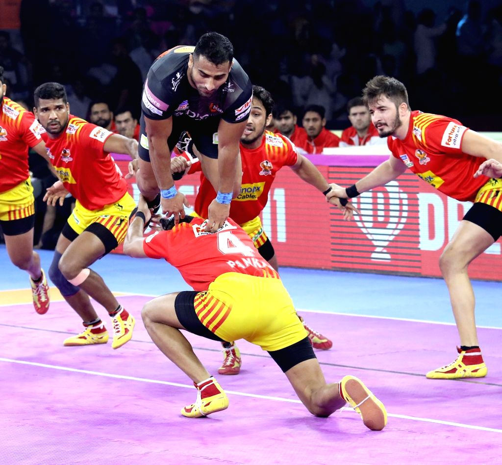 Players in action during Pro Kabaddi Season 7 match between U Mumba and Gujarat Fortunegiants at Sawai Mansingh Indoor Stadium in Jaipur on Sep 22, 2019.