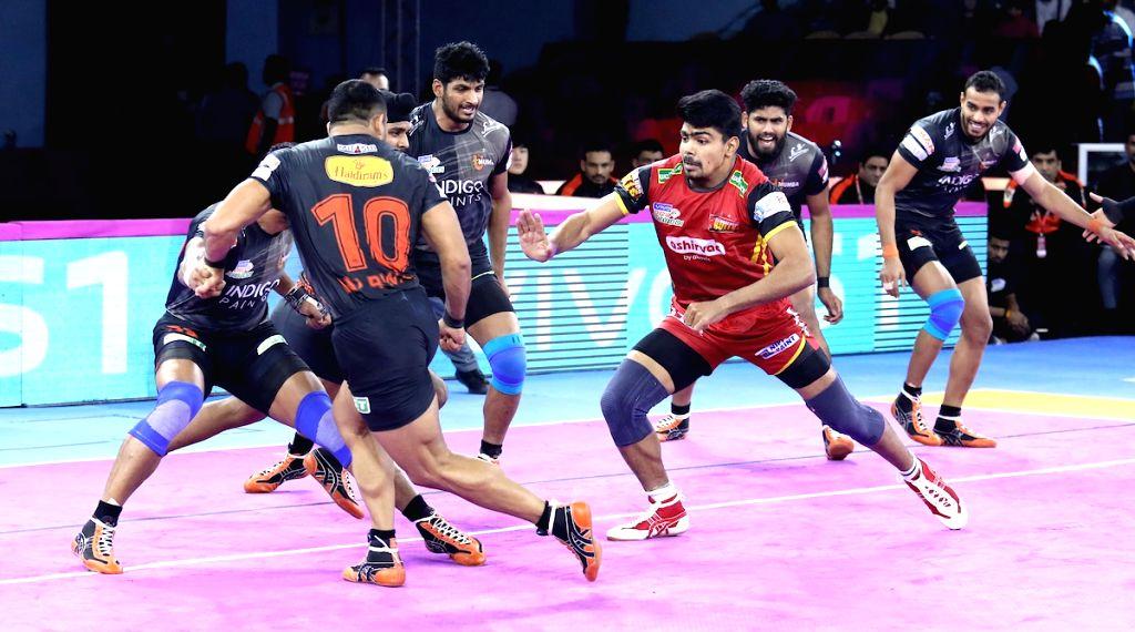 Players in action during Pro Kabaddi Season 7 match between U Mumba and Bengaluru Bulls at Sawai Mansingh Indoor Stadium in Jaipur on Sep 27, 2019.
