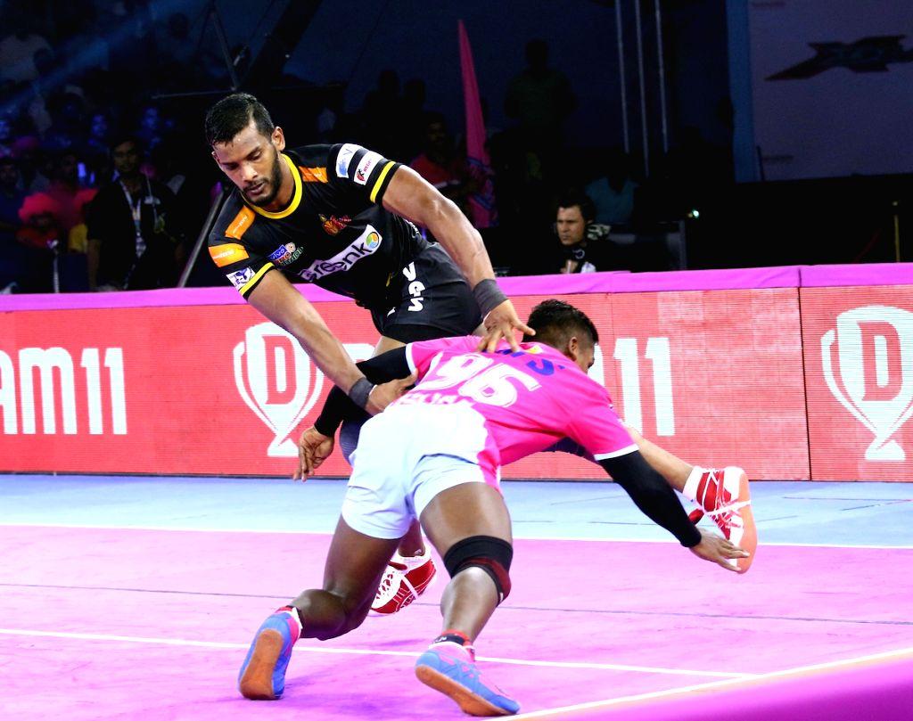 Players in action during Pro Kabaddi Season 7 match between Jaipur Pink Panthers and Telugu Titans at Sawai Mansingh Indoor Stadium in Jaipur on Sep 27, 2019.