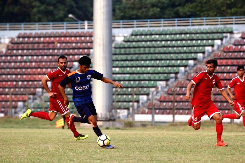 Players in action during Santosh Trophy match between Maharashtra and Chandigarh at Rabindra Sarobar stadium in Kolkata on March 23, 2018.