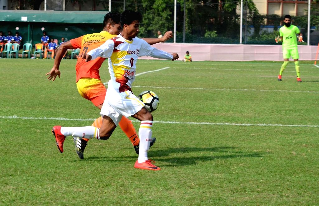 Players in action during Santosh Trophy Semi Final between Bengal and Karnataka at Sailen Manna Stadium in Howrah on March 30, 2018.