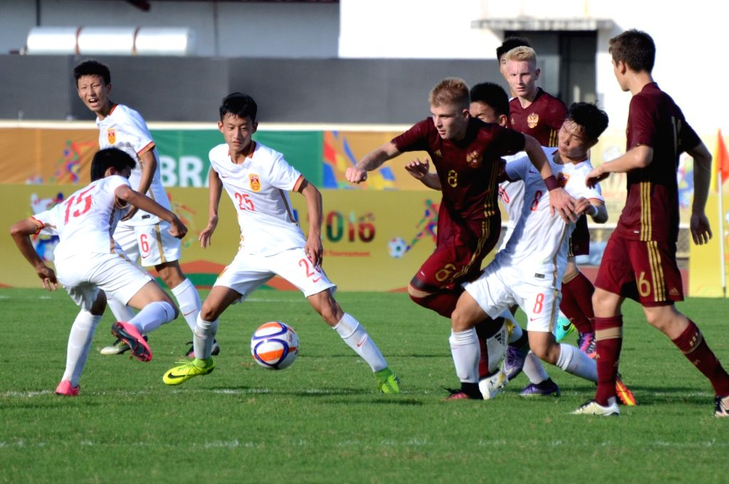 Players in action during the 1st BRICS U17 football tournament between Russia and China in Bambolim, Goa on Oct 7, 2016.