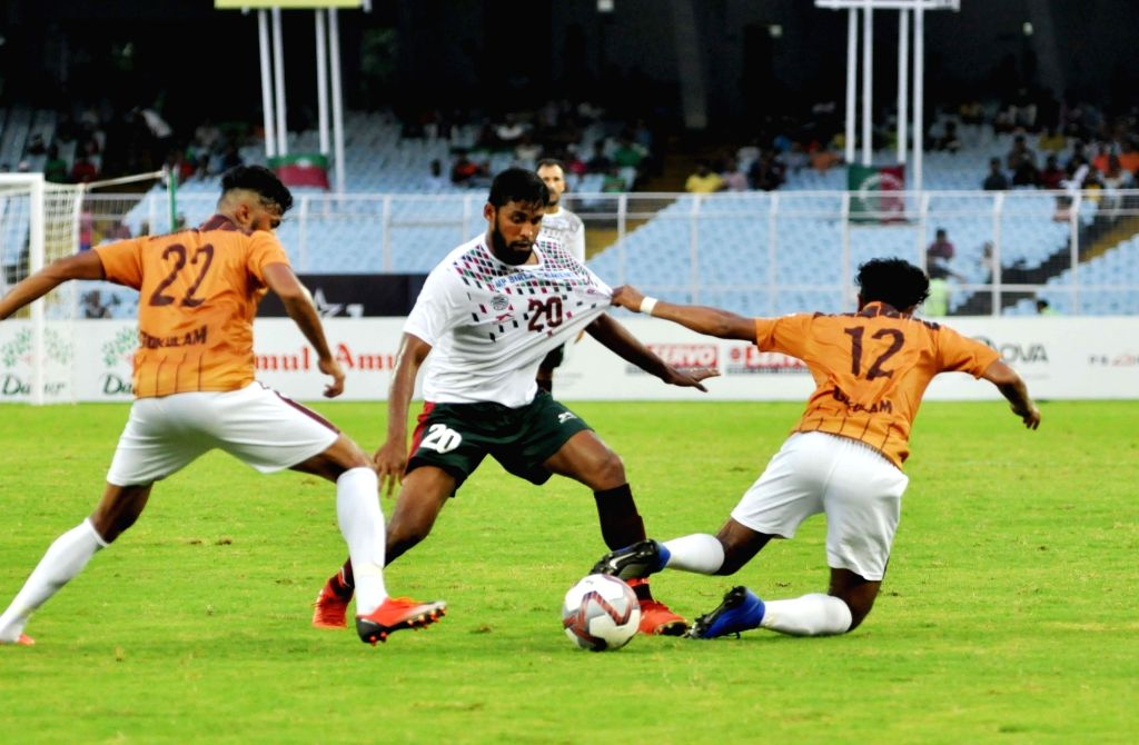 Players in action during the Durand Cup final between Mohun Bagan A.C. and Gokulam Kerala FC, in Kolkata on Aug 24, 2019.
