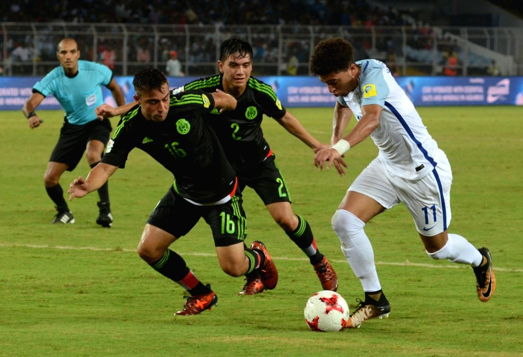Players in action during the FIFA U17 World Cup India 2017 Group F match between England and Mexico at Salt Lake Stadium in Kolkata on Oct 11, 2017.