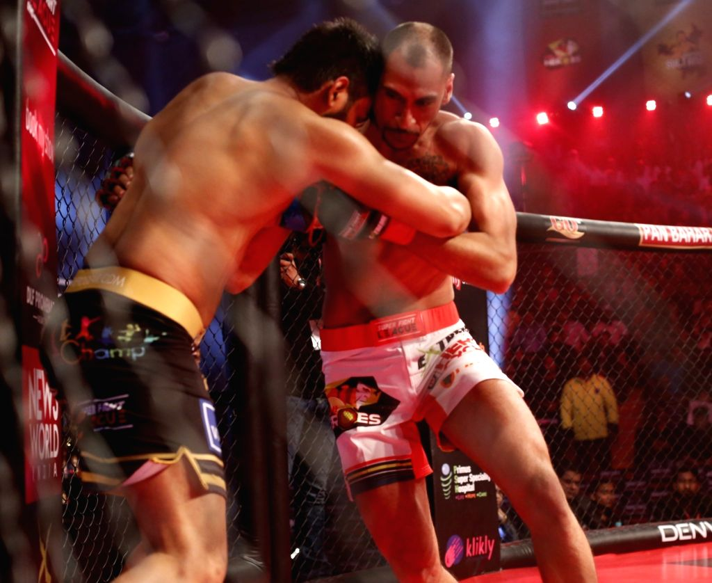 Players in action during the Super Fight League (SFL) between Sher-e-Punjab and Delhi Heroes in New Delhi on Feb 25, 2017.