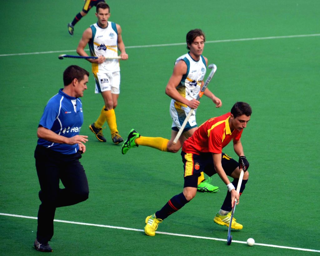 Players of Australia and Spain in action during a match of Australia and Spain in Hero Hockey Junior World Cup 2013 played in New Delhi on Dec.8, 2013.