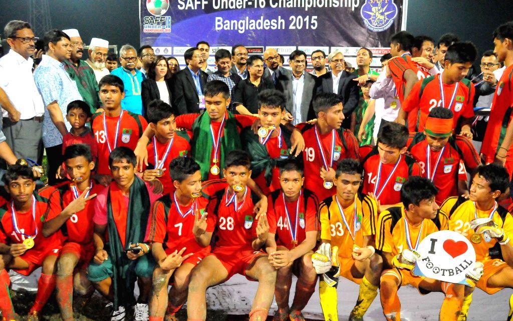 Players of Bangladesh pose for a group photo at the Sylhet stadium in Sylhet, Bangladesh, Aug. 18, 2015. Bangladesh clinched the South Asian Football Federation ...