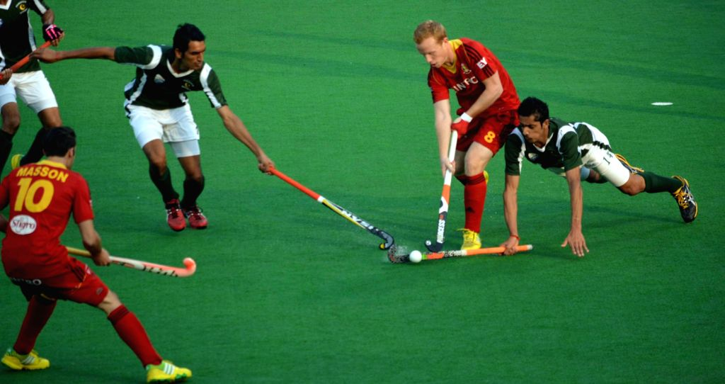 Players of Belgium and Pakistan in action during a match of Belgium and Pakistan in Hero Hockey Junior World Cup 2013 played in New Delhi on Dec.10, 2013.