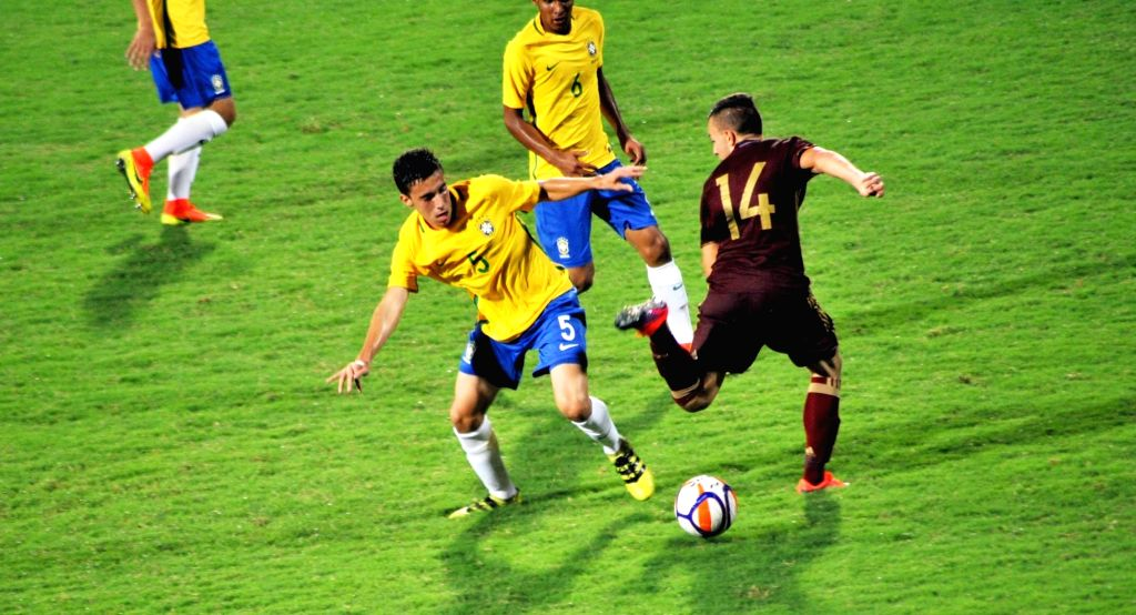 Players of Brazil and Russia in action during the BRICS U17 Football Tournament at Bambolim, Goa on Oct 9, 2016.