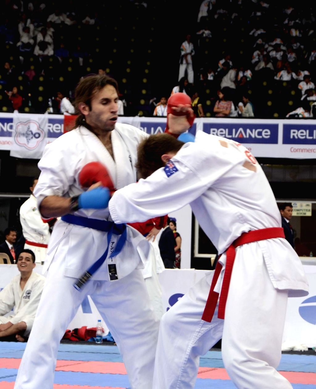 Players of  England and Australia in action during 6th Word Gojukai Karate Championship at NSCI in Mumbai on Dec.13, 2013.