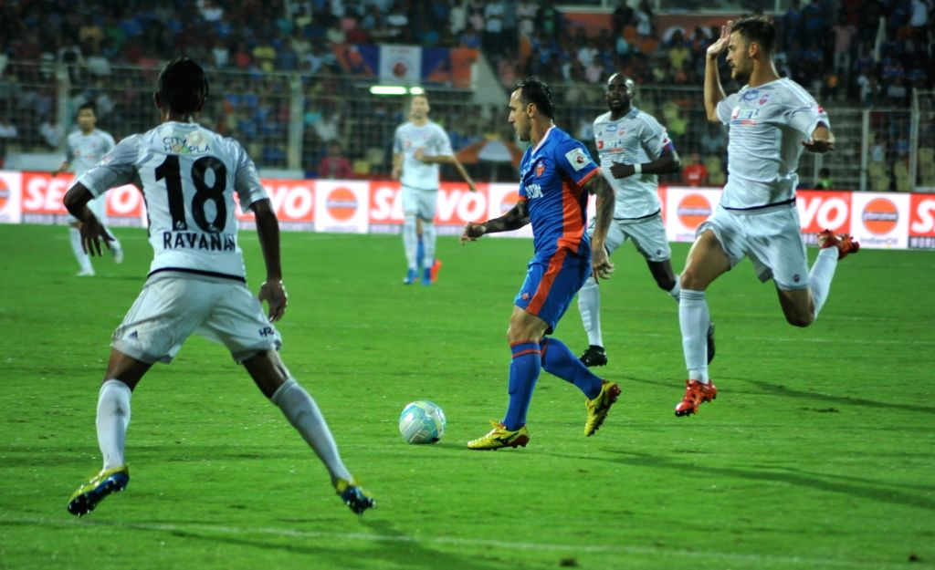 Players of FC Goa and FC Pune in action during an ISL match at Fatorda, Goa on Oct 8, 2016.