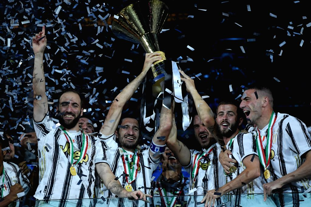 Players of FC Juventus celebrate with the trophy at the end of the Serie A football match between FC Juventus and Roma in Turin, Italy, Aug 1, 2020.