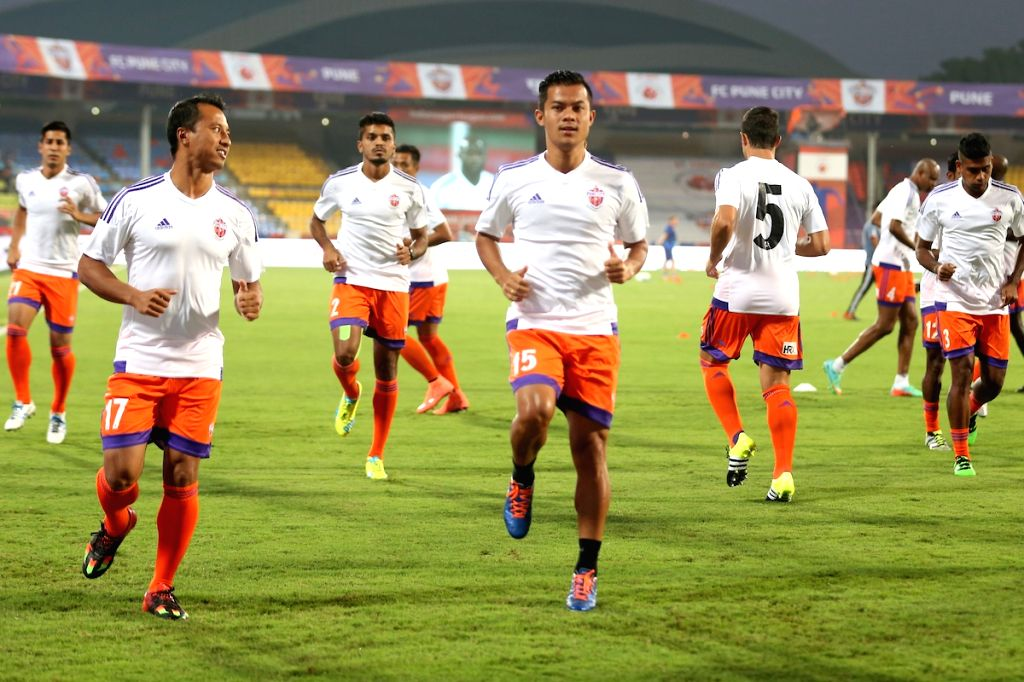 Players of FC Pune City during a practice session in Pune on Oct 22, 2016.