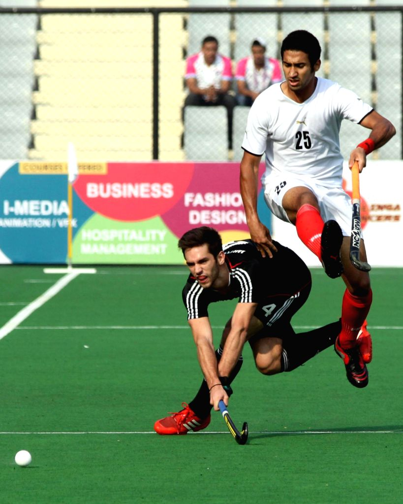 Players of Germany and Egypt in action during a match of Germany and Egypt in Hero Hockey Junior World Cup 2013 played in New Delhi on Dec.10, 2013.