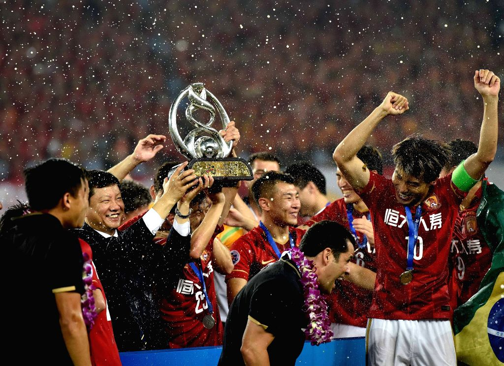 Players of Guangzhou Evergrande celebrate during the awarding ceremony of the AFC Champions League final match between Guangzhou Evergrande and Al Ahli of United ...