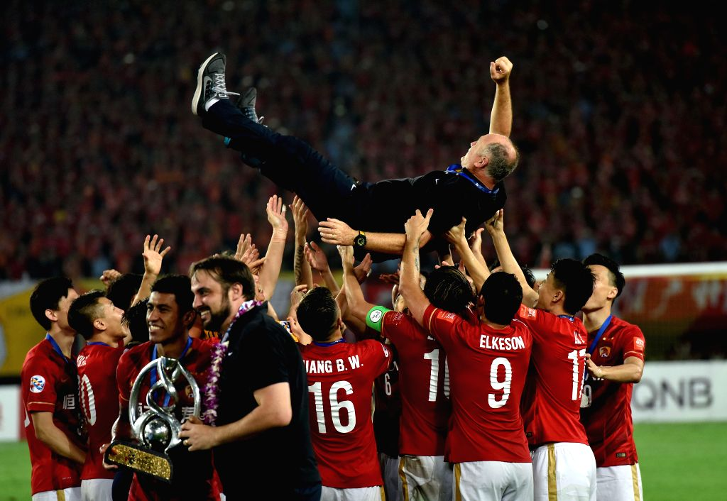 Players of Guangzhou Evergrande lift their head coach Luiz Felipe Scolari (Top) after the awarding ceremony of the AFC Champions League final match between ...