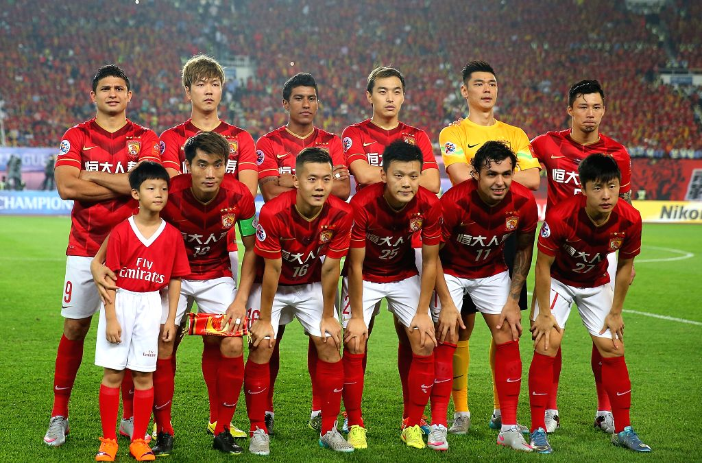 Players of Guangzhou Evergrande pose for photos before the 2nd round of the AFC Champions League final match between Guangzhou Evergrande and Al Ahli of United ...