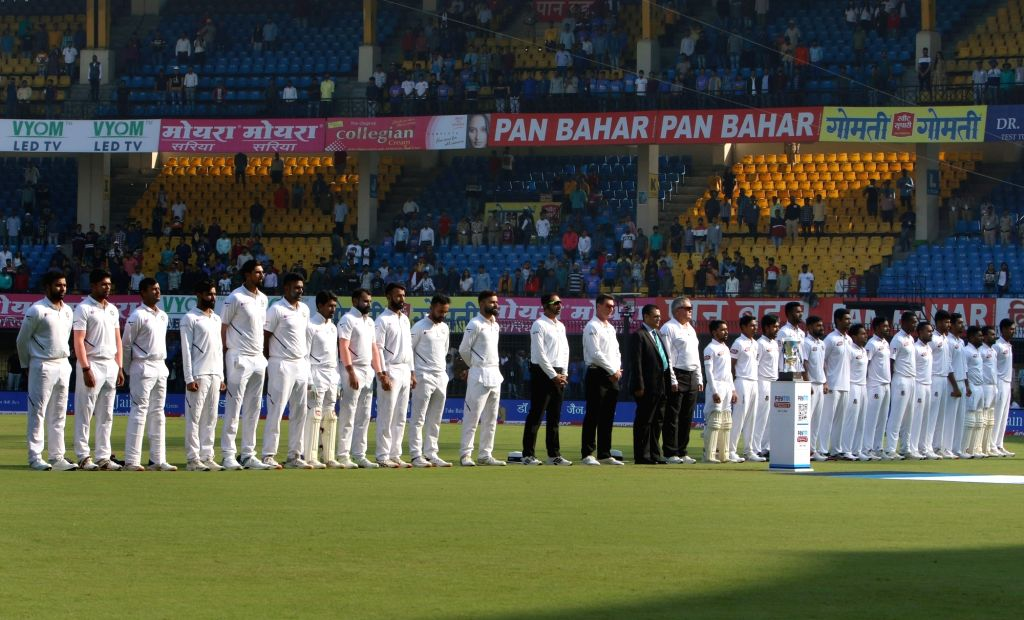 Players of India and Bangladesh stand for their National Anthem ahead of the 1st Test match between India and Bangladesh at Holkar Cricket Stadium in Indore, Madhya Pradesh on Nov 14, 2019.