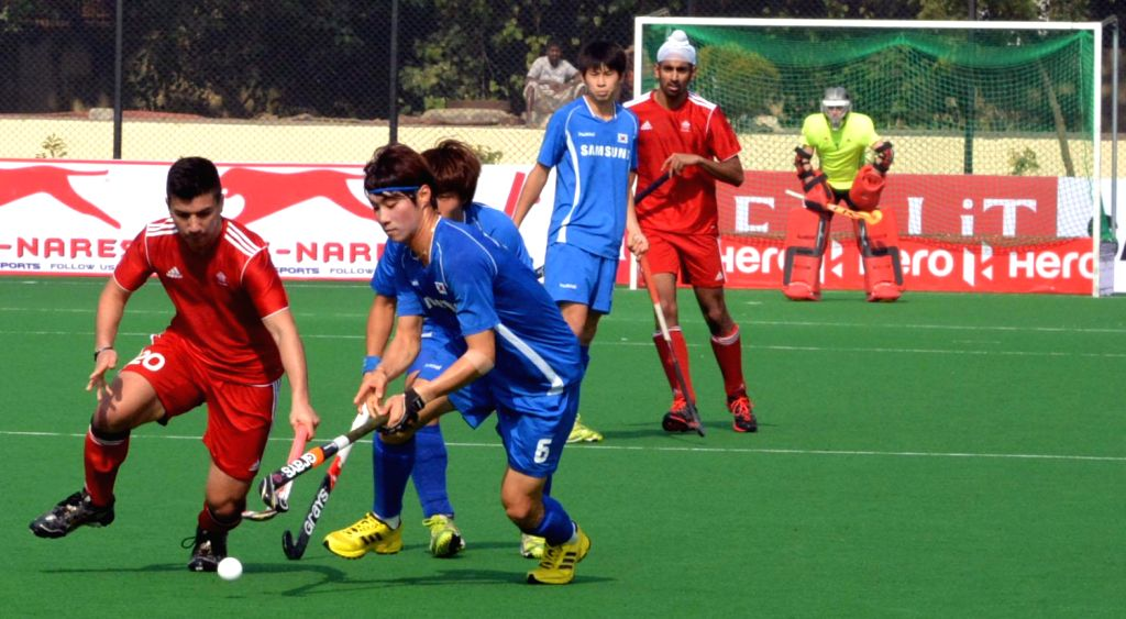 Players of India and Netherlands in action during a match of India and Netherlands in Hero Hockey Junior World Cup 2013 played in New Delhi on Dec.6, 2013.