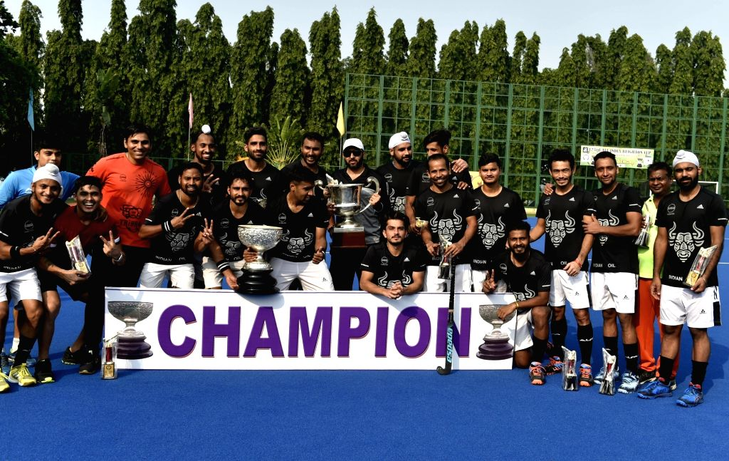 Players of Indian Oil Corporation Ltd celebrate after winning Beighton Cup match against Punjab National Bank at SAI complex, in Kolkata on Nov 11, 2019. Indian Oil Corporation Ltd won the ...