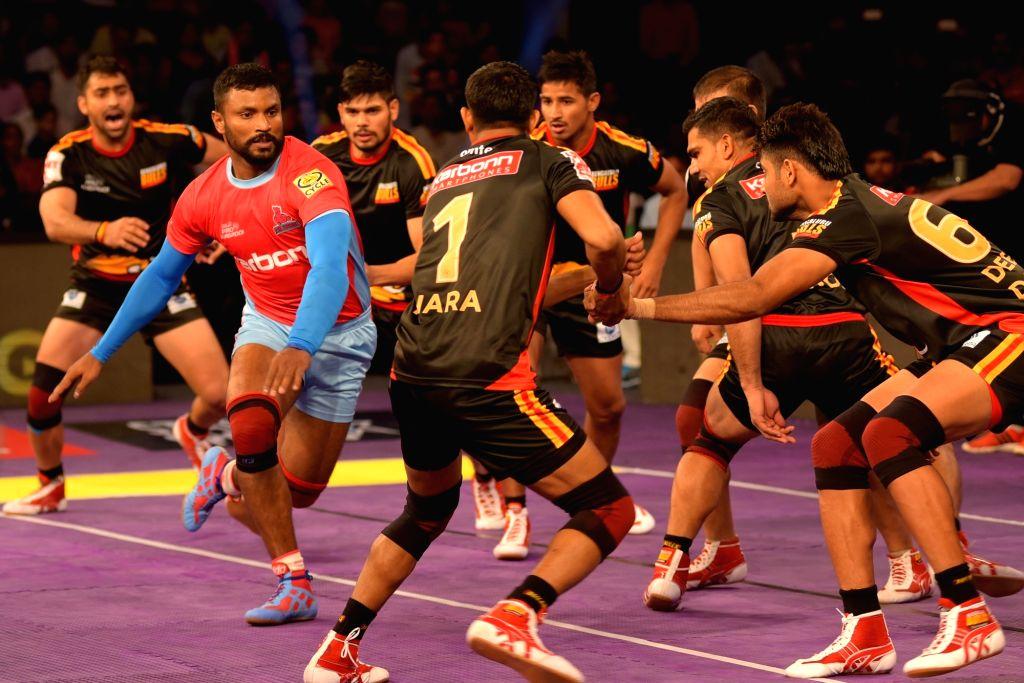 Players of Jaipur Pink Panther and Bengaluru Bulls in action during a Pro Kabaddi League match at Sawai Mansingh Indoor Stadium in Jaipur, on June 30, 2016.