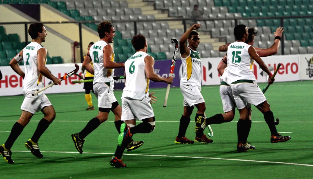 Players of Malaysia and RSA in action during a match of Malaysia and RSA in Hero Hockey Junior World Cup 2013 played in New Delhi on Dec.8, 2013.