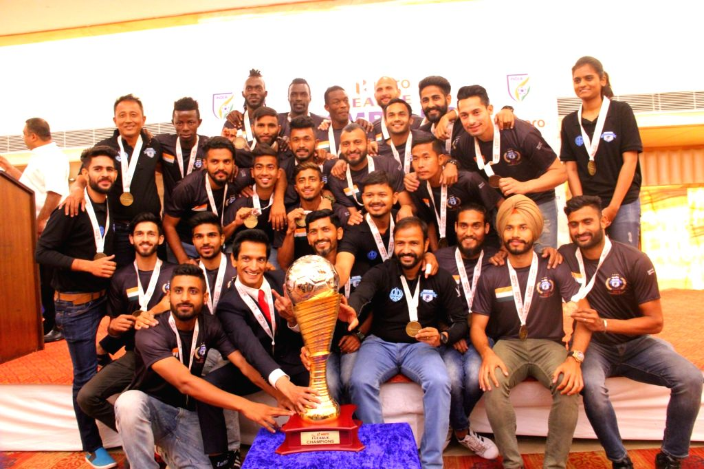 Players of Minerva Punjab FC with their I-League Trophy during a presentation ceremony in Chandigarh on March 22, 2018. Minerva Punjab FC created history by defeating Churchill Brothers ...