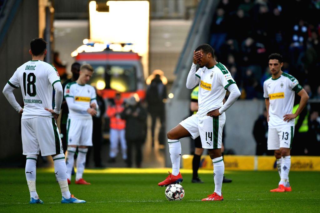 Players of Moenchengladbach react after the Bundesliga match between Borussia Moenchengladbach and VfL Wolfsburg in Moenchengladbach, Germany, Feb. 23, ...
