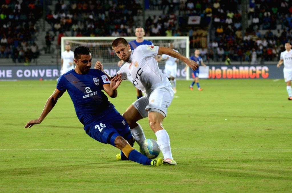 Players of  Mumbai City FC and NorthEast United FC in action during an ISL match at Mumbai's Andheri Sports Complex in Mumbai, on Oct 7, 2016.