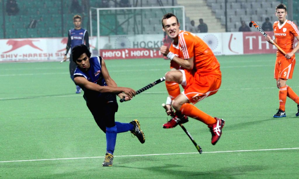 Players of Netherlands and Malaysia in action during a match of Netherlands and Malaysia in Hero Hockey Junior World Cup 2013 played in New Delhi on Dec.15, 2013.