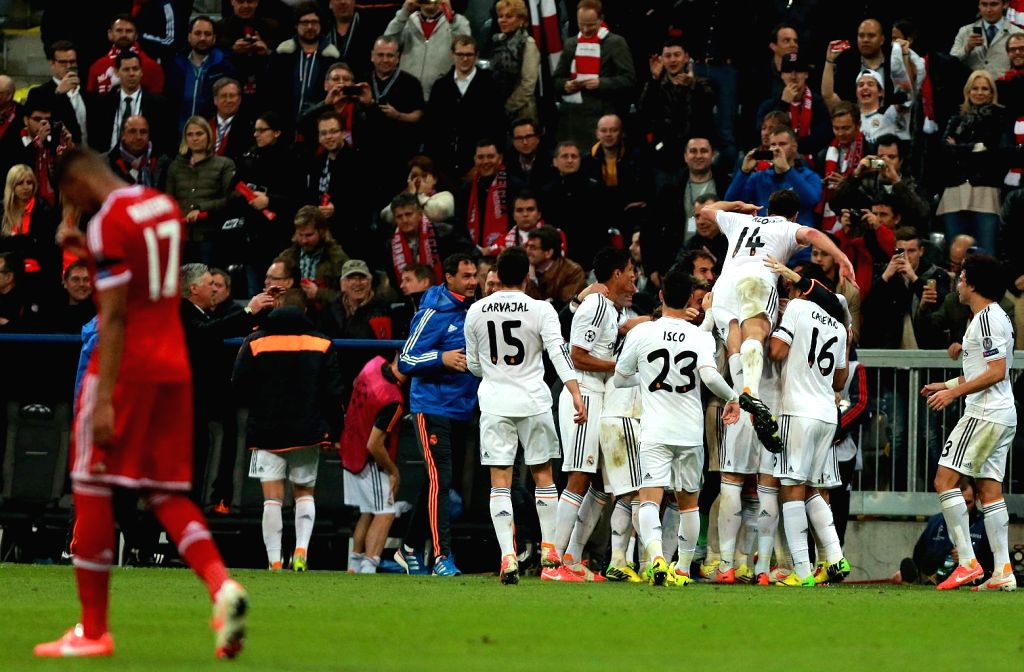 Players of Real Madrid celebrate a goal during the UEFA Champions League Semi Final second leg match between FC Bayern Muenchen and Real Madrid at Allianz Arena in Madrid, Spain on April 29, 2014. ...