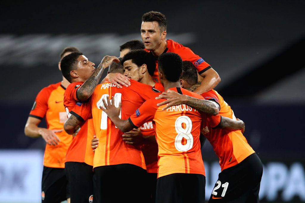 Players of Shakhtar Donetsk celebrate after scoring during the UEFA Europa League quarterfinal between Shakhtar Donetsk and FC Basel in Gelsenkirchen, ...