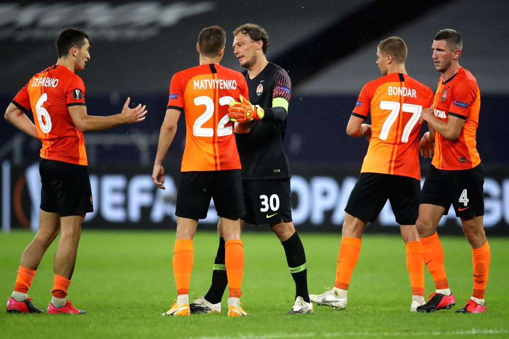 Players of Shakhtar Donetsk react after the UEFA Europa League quarterfinal between Shakhtar Donetsk and FC Basel in Gelsenkirchen, Germany, Aug. 11, 2020.
