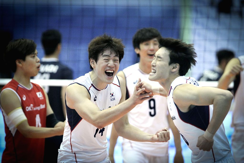 Players of South Korea celebrate during the match against Iran at the 18th Asian Men's Volleyball Championship at Azadi Stadium in Tehran, Iran, on Aug. 4, 2015. ...