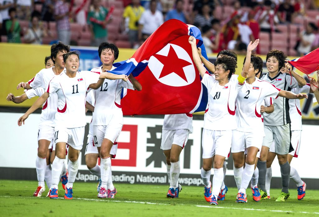 Players of the Democratic People's Republic of Korea (DPRK) celebrate victory after the match against South Korea at the 2015 EAFF(East Asian Football Federation) ...