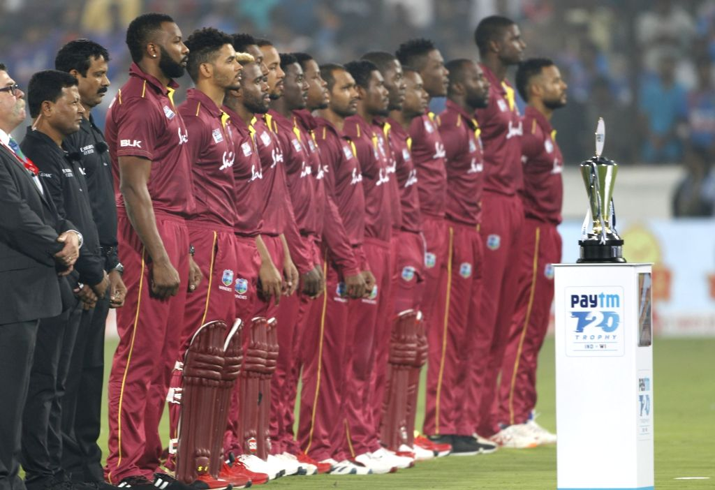 Players of West Indies stand for National Anthem ahead of the first T20I match between India and the West Indies at the Rajiv Gandhi International Stadium in Hyderabad on Dec 6, 2019.