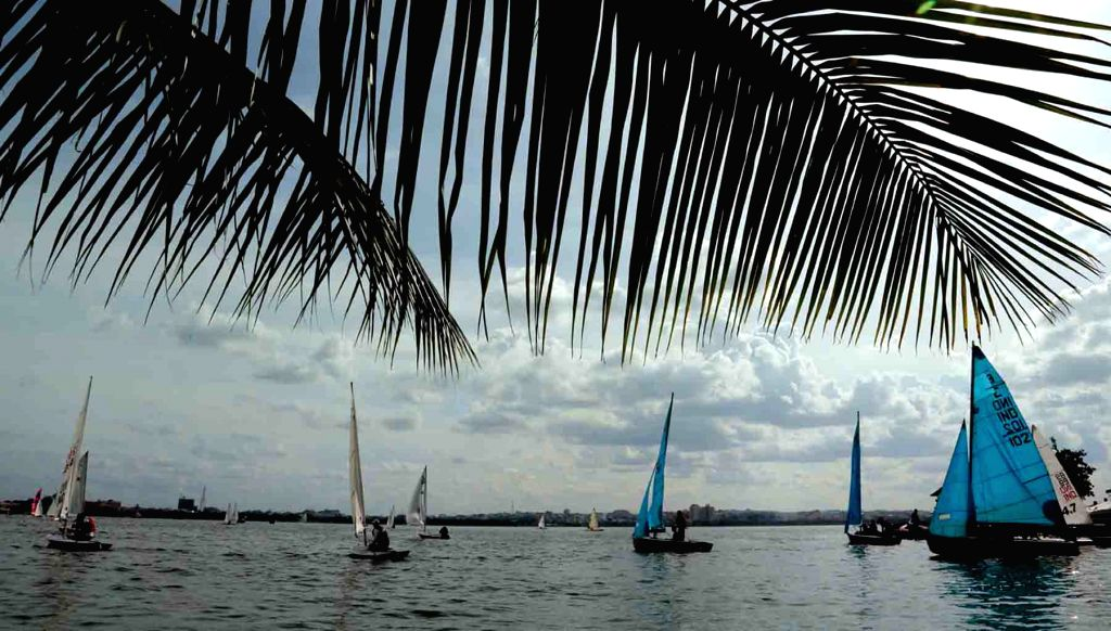 Players participate during a multi class sailing championship at Hussain Sagar lake in Hyderabad on June 28, 2016.